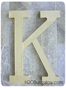 Large letter before metallic faux paint