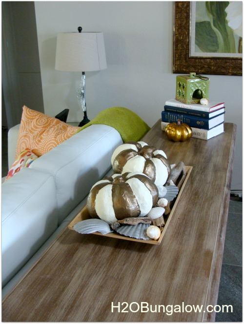 pumpkin centerpiece on sofa table