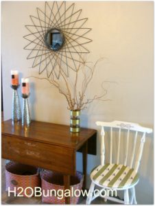 gold striped vase and chair