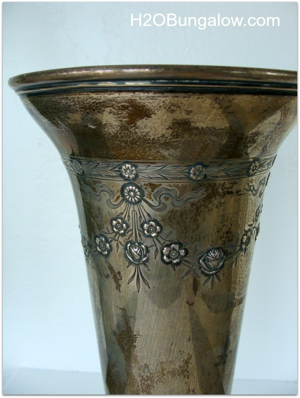 close up of tarnished antique silver vase