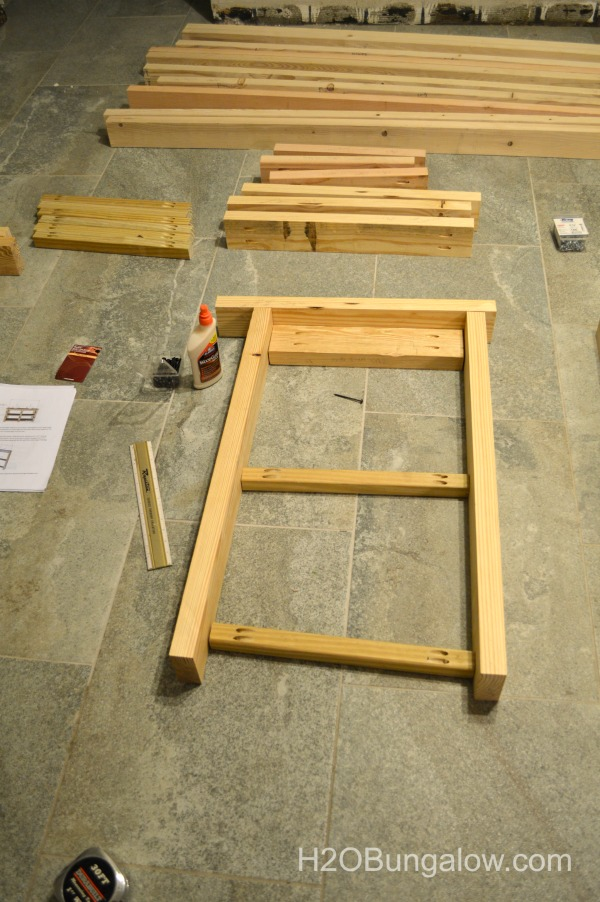 lay-boards-together-before-assembly-DIY-bathroom-open-shelf-vanity-H2OBungalow