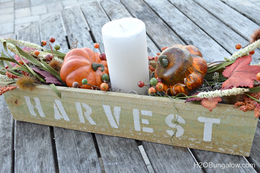 It looks like pallet wood, it's still rough cut with texture and character, but you don't have to anything apart! Make this simple wood trough box from a new fence post . Add a stencil and you've got a super fall decor item. www.H2OBungalow.com #falldecor #fall #powertoolproject