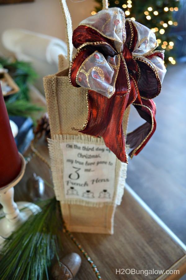 Add-bow-to-personalized-Twelve-Days-of-Christmas-gift-bag-H2OBungalow
