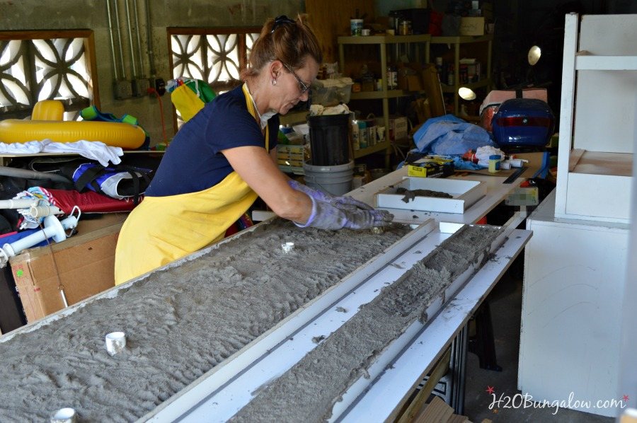 Patting the wet concrete for DIY concrete counter top