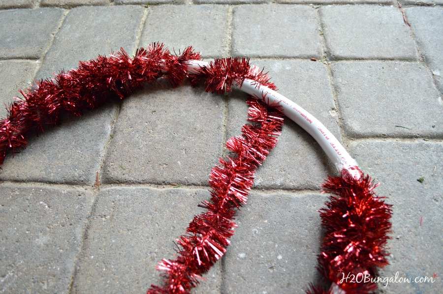 Wrap-tinsel-around-outdoor-pvc-Christmas-decorations-H2OBungalow