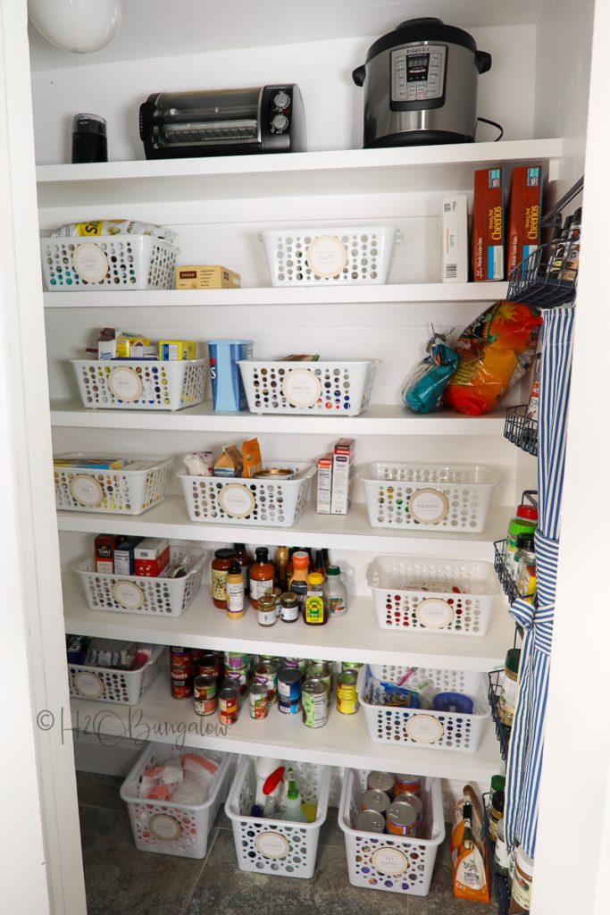 organized pantry with bins