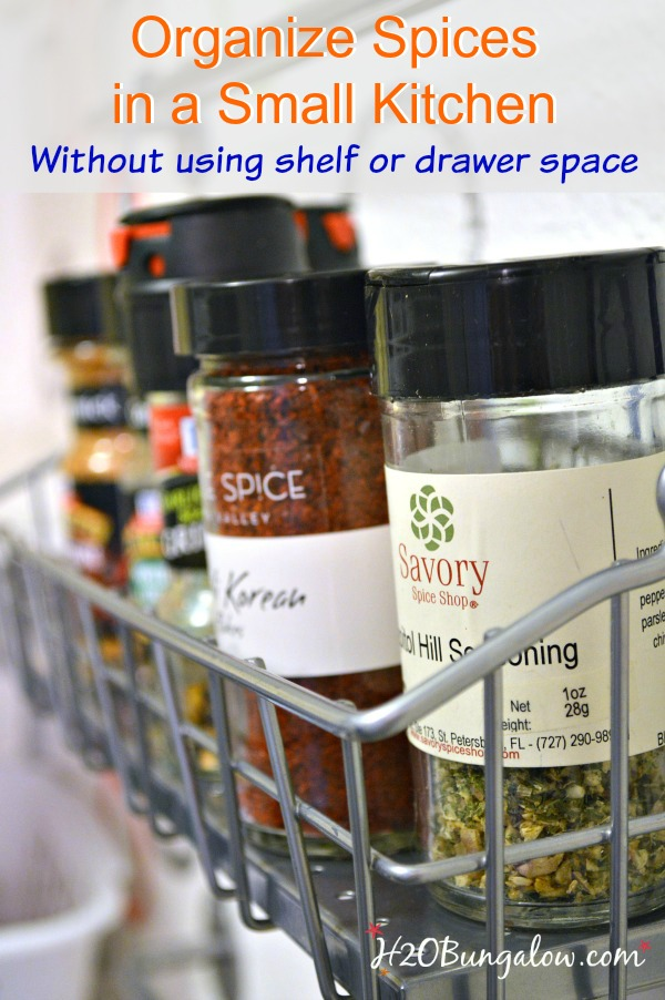 Organizes spices in unused space...a wall! Use these nifty racks to hold and keep your spices easy to see and reach. This soultion freed up a huge amount of space in my kitchen storage www.H2OBungalow.com #organize #smallhomesolution