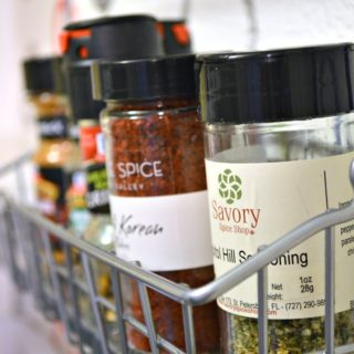 Organize-spices-on-a-wall-to-save-counter-space-H2OBungalow