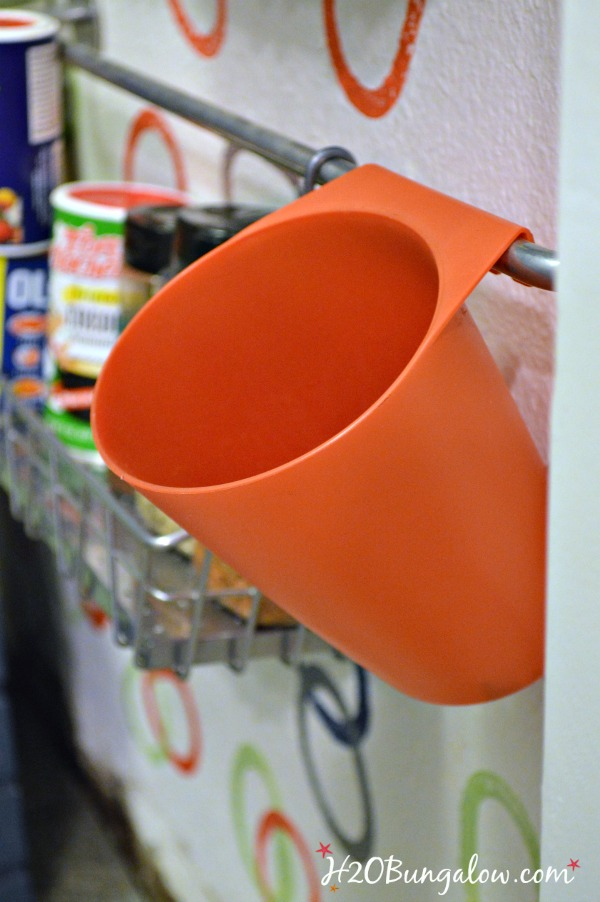 Use-cups-on-wallspice-racks-to-hold-items-and extra-spices-H2OBungalow