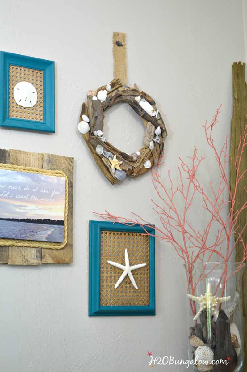 gallery wall of coastal items