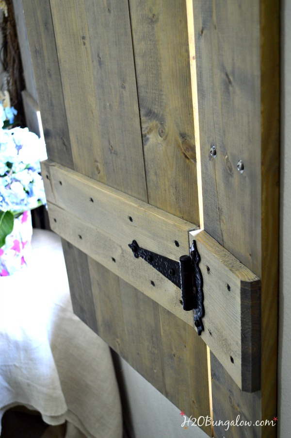 Build your own set of old world inspired wood shutters. Finish raw wood with an aging product and you have a realistic vintage appeal on a DIY budget! Good tutorial. www.H2OBungalow.com #woodworking #powertoolproject