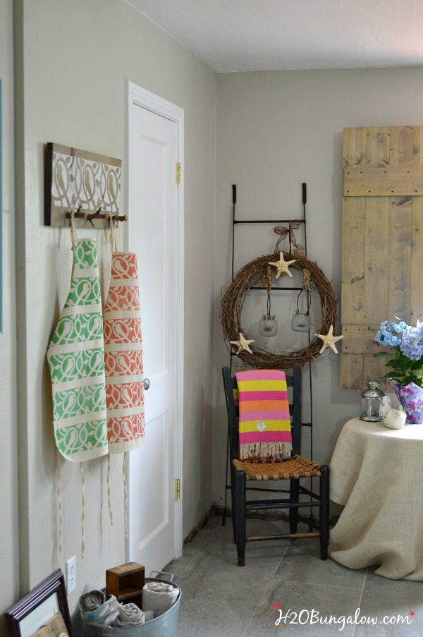Stenciled-coat-rack-made-with-twig-branches-H2OBungalow
