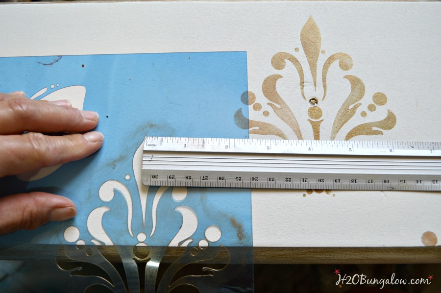 Stenciled-damask-onto-distressed-fresser-drawer-H2OBungalow