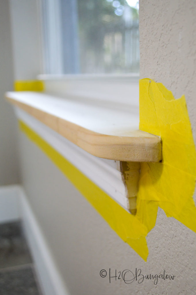 delicate surface painters tape around window ledge