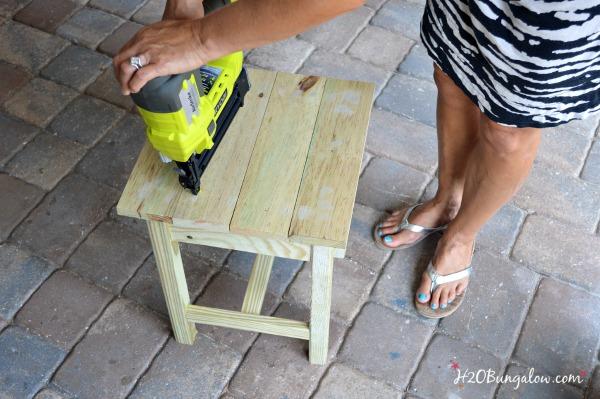 Use Ryobi Airstrike Brad Nailer to attach top ontothe DIY outdoor patio table H2OBungalow