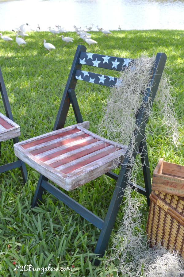 Red white and blue DIY patriotic folding chais painted and decoupaged by H2OBungalow See this project and many more fun patriotic themed projects in our themed tour