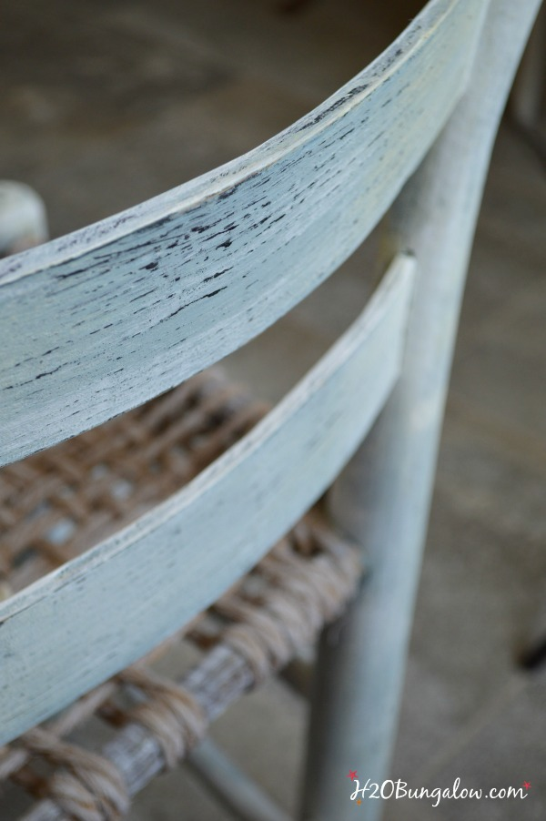 light dirstressing adds character to this coastal rustic accent chair.  Makeover by H2OBungalow