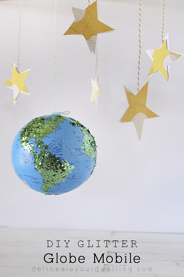 DIY Sunday Showcase weekly feature DIY Glitter Globe Mobile from Delineate Your Dwelling.  Click over to see the rest of this weeks fabulous features!   www.H2OBungalow.com