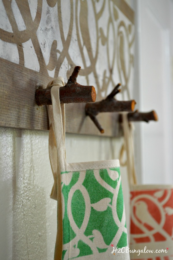 Organize a front entry with a fun and unique coat rack made with tree branches. H2OBungalow