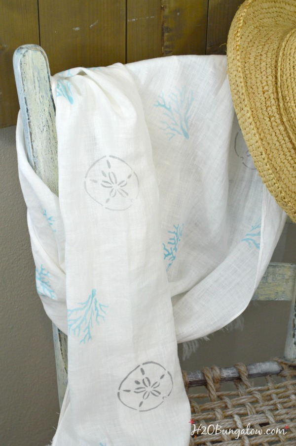 DIY linen scarf coastal style with stenciled sand dollars and coral shapes in soft shades of turquoise and silver.  Simple tutorial to make one as a beautiful gift or keep for yourself.  Linked to Scarf Week where you'll find lots more fantasic scarf projects!  H2OBungalow.com #Scarfweek #scarf