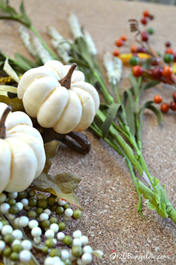 "Make a simple and festive monogram fall wreath with starfish, acorns and pumkins. Tuck sprigs of greenery into the grapevine wreath for filler. See this and 30 more fall projects in the Fall Ideas Tour. www.H2OBungalow.com #Fallwreath ""Falldecor #FallIdeasTour"
