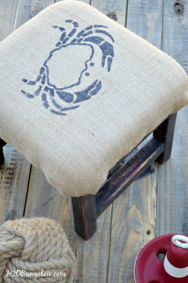 DIY coastal burlap footstool with crab graphic. Easy tutorial to cushion something in burlap and add a graphic. Linked to Themed Furniture Makeover Day and many more black furniture makeovers www.H2OBungalow.com #paintedfurniture
