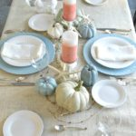 Coastal holiday tablescape mixes elegant casual and rustic elements seamlessly in a comfortable setting. See this and 18 other traditional and not so traditional holiday tablescapes and centerpieces www.H2OBungalow.com #holidaytablescape #coastaltablescape