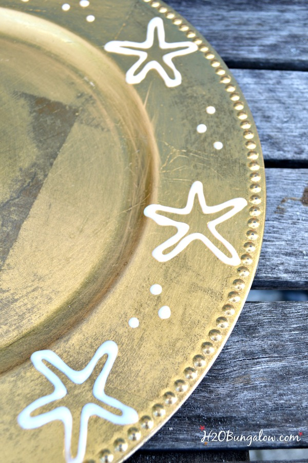 Upcycle old chargers with a fun design, paint and seal to add interest to your holiday tablescape. H2OBungalow.com #tablescape