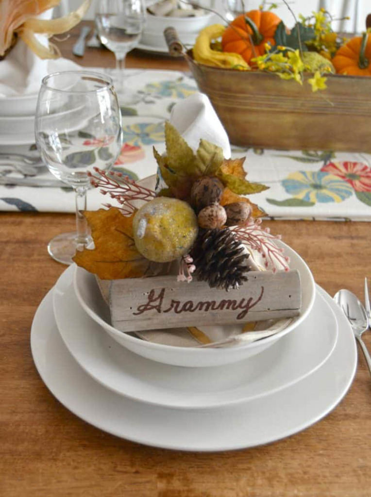 place setting with fall floral spray and wooden place card holder that says grammy