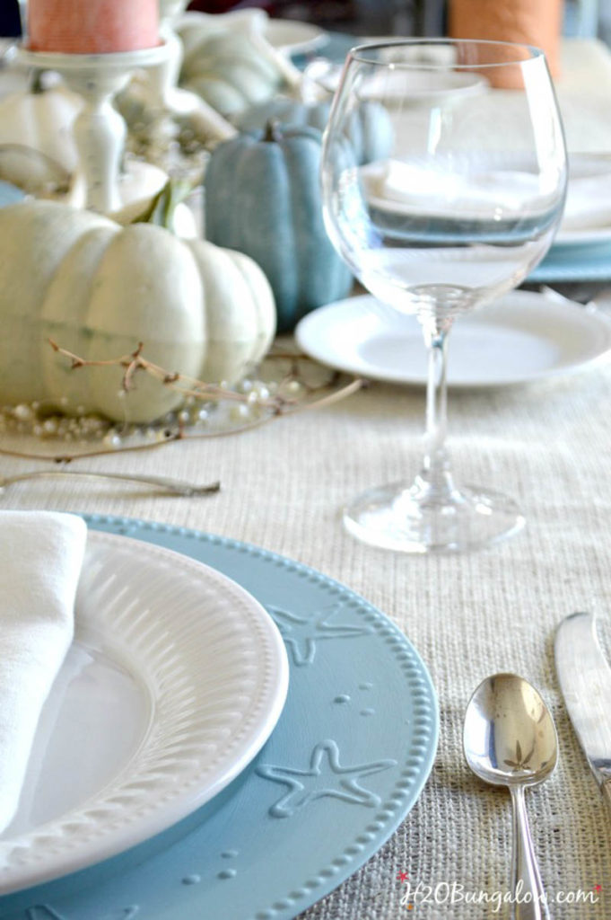 blue starfish charger with white plate and napkin table setting
