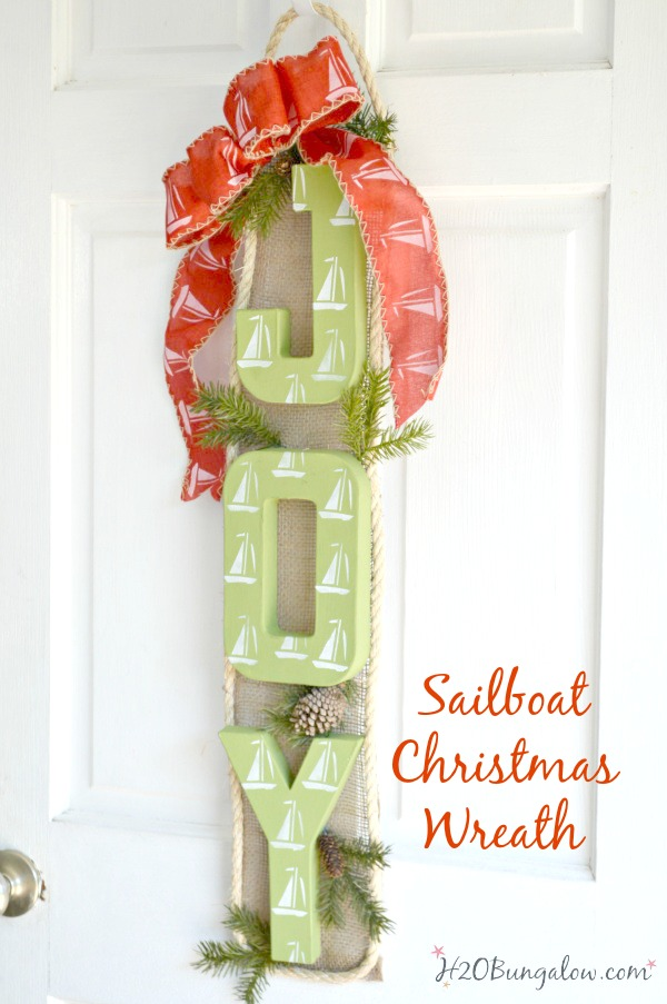Nautical sailboat Christmas wreath puts a new twist on a coastal themed wreath for the holidays. I love indoor or on the front door! H2OBungalow