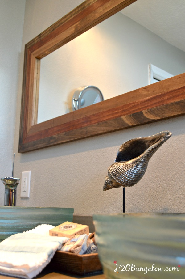 Modern DIY rustic mirror frame tutorial. Take a plain $5 cheap framed mirror and transform in into a unique staement piece that's anything but ordinary! www.H2OBungalow.com #powertoolchallengeteam