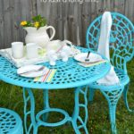 Pinterest pin of turquoise painted metal table and chair after photo