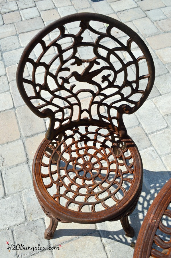 rusted outdoor metal chair before paint makeover