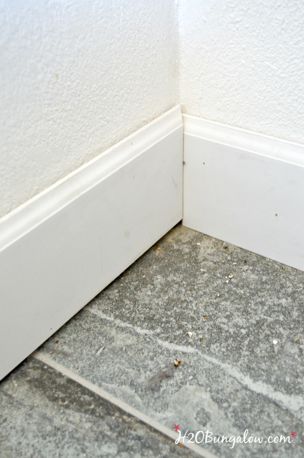 close up of baseboards on uneven floors