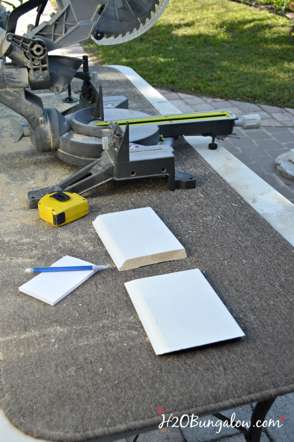 miter saw set up for DIY baseboards