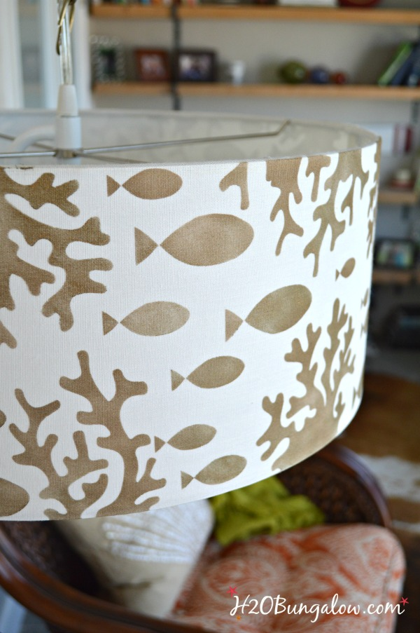 Tutorial to show how to make an simple stenciled DIY hanging pendant light from a drum lampshade, a chain and a light conversion kit. Easy DIY.