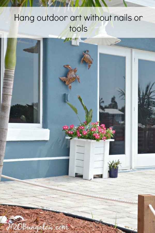 Diy Tutorial To Hang Outdoor Wall Art Without Nails Or Tools On Stucco Siding