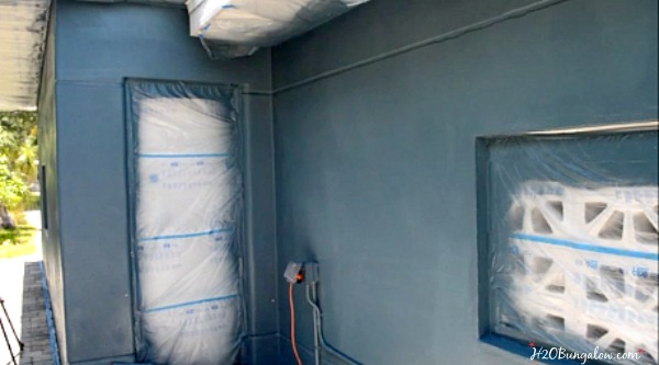 Painting-exterior-of-home-with-paint-sprayer-2-H2OBungalow