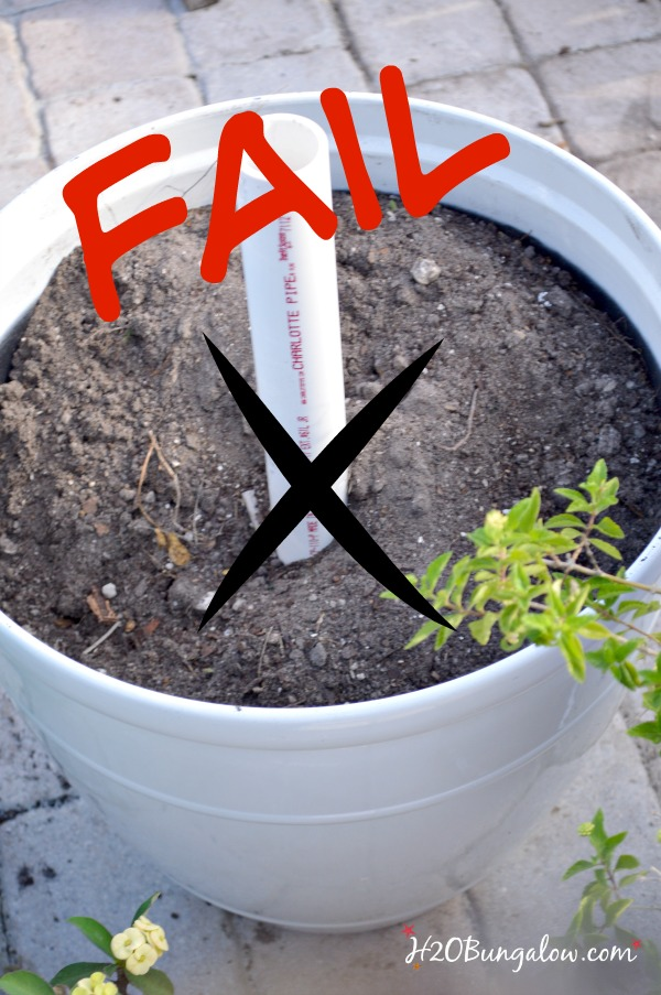 bucket filled with dirt and pvc pipe with fail written in red