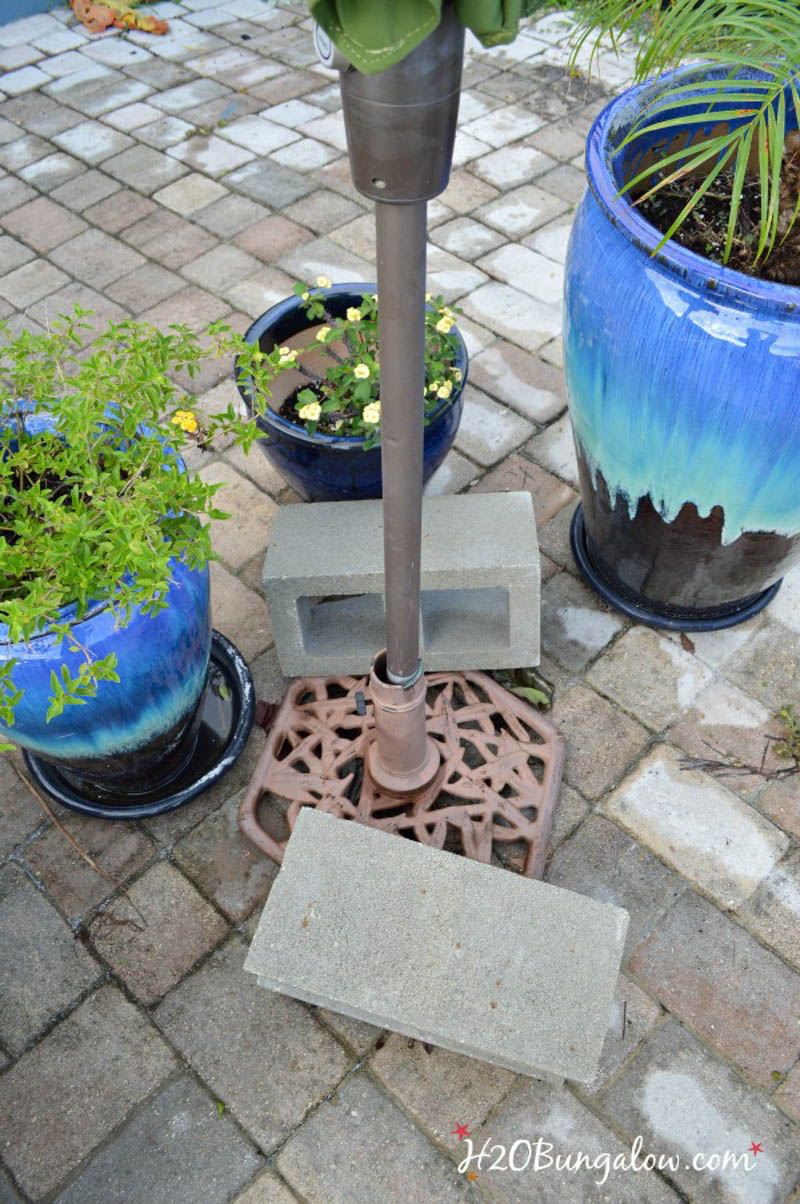 umbrella stand being held in place by cinder blocks