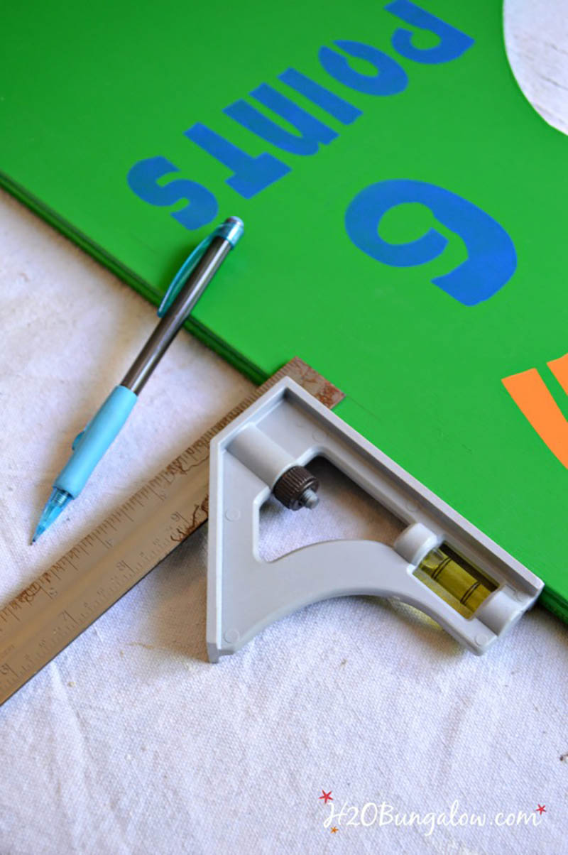 striping board of DIY football toss game with t-square and pencil