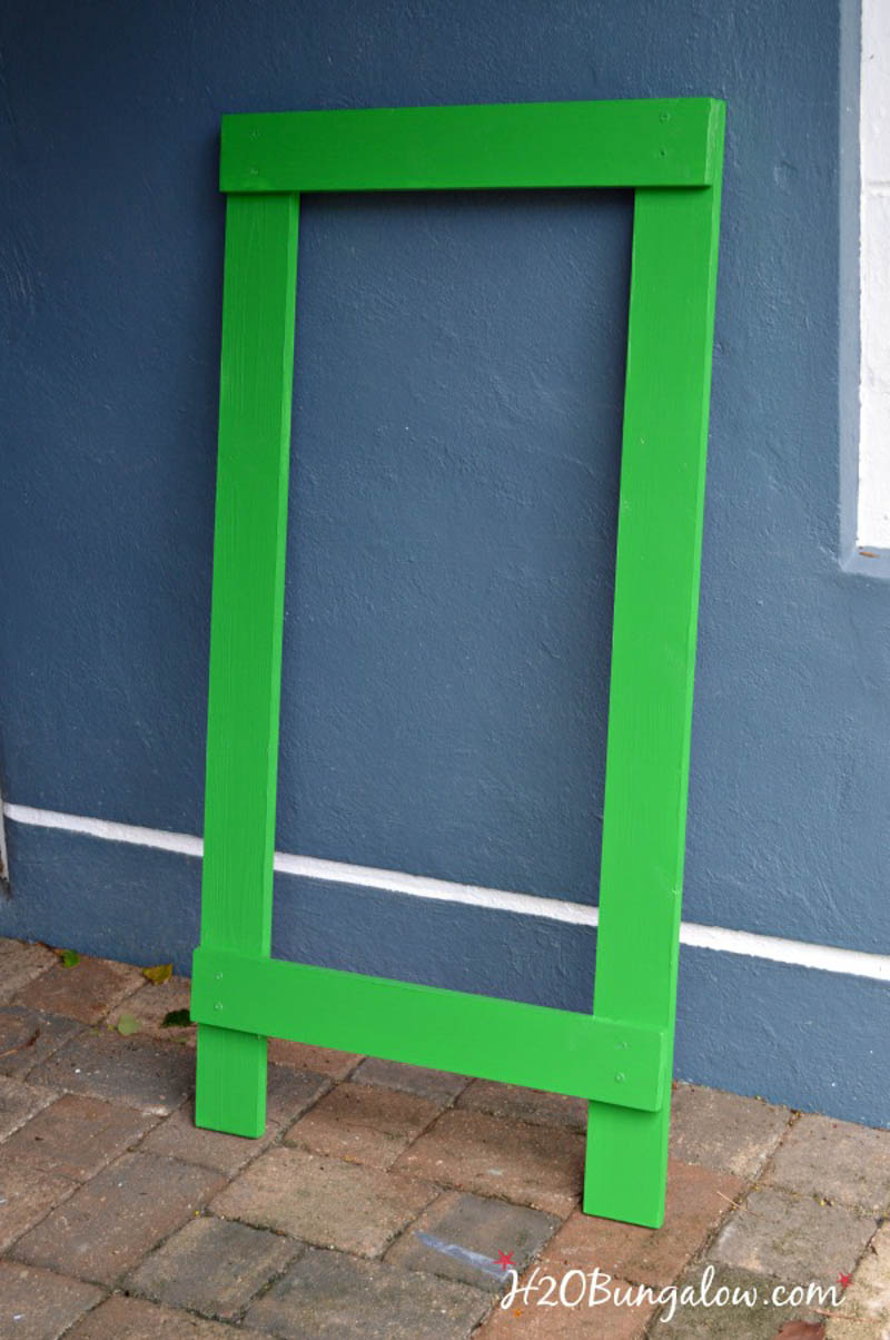 assembled frame of DIY football toss game painted green