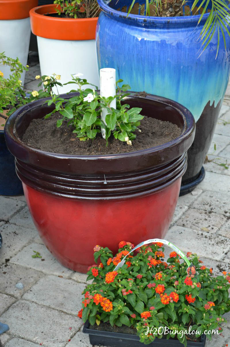 umbrella planter stand with dirt and flowers before adding umbrella