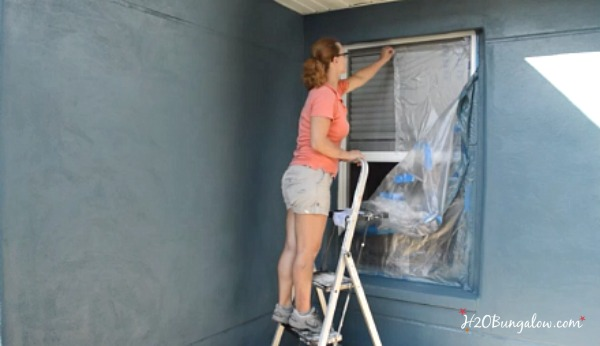 removing-dropcloth-protection-after-spray-painting-house-H2OBungalow