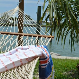 striped summer throw on hammock facing the ocean view