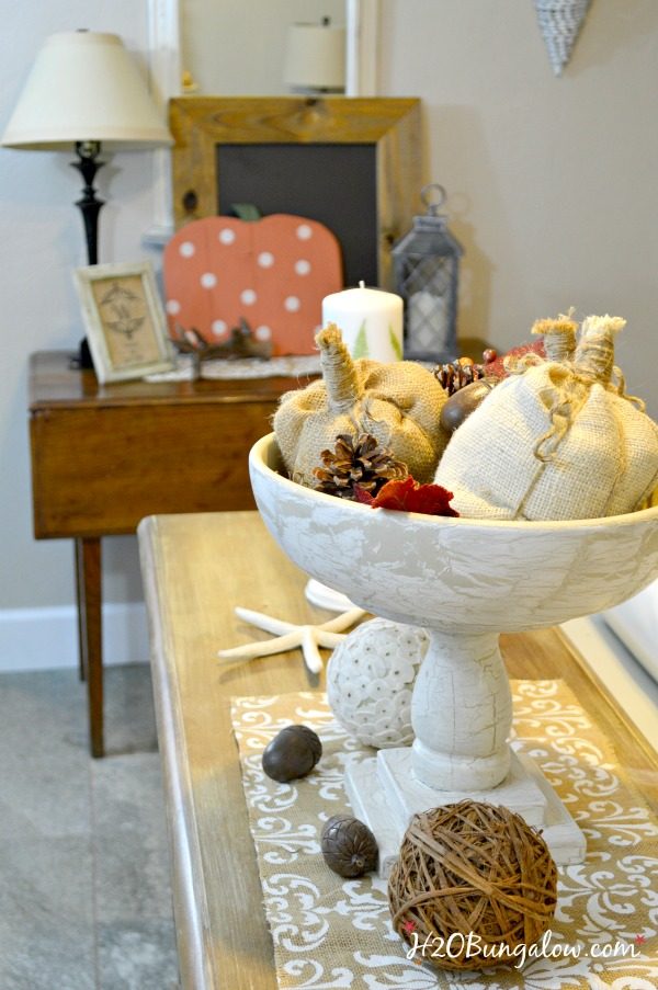 Easy step by step tutorial to make no sew fabric pumpkins. Stunning in burlap, velvet or another textured fabric. Great for fall and holiday vignettes.