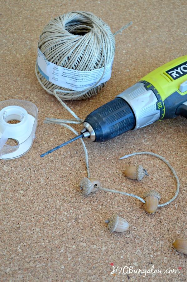 drill, twine, scotch tape, and acorns