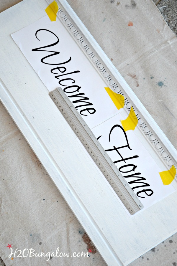 "Easy DIY tutorial to make a repurposed headboard coat rack with ""Welcome Home"" saying. Easy bed headboard upcycle project."