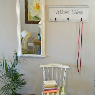 """Easy DIY tutorial to make a repurposed head board coatrack with """"Welcome Home"""" saying. Easy bed headboard upcycle project."""